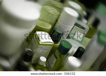 cosmetics with artistic blur on edges - stock photo