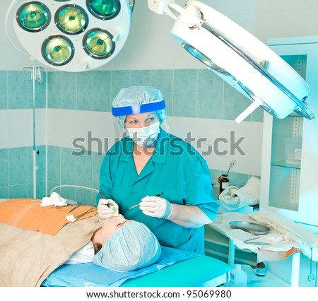Cosmetology medical operation by plastic surgeon - stock photo