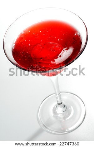 Cosmopolitan - Alcoholic Cocktail made of Gin Cointreau, Lemon Juice and Grenadin Syrup. Isolated on White Background - stock photo