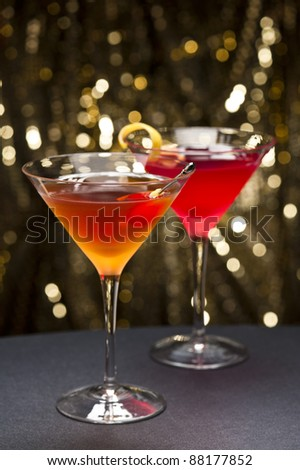 Cosmopolitan and Manhattan cocktail nice garnished with gold glitter back ground - stock photo