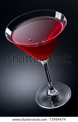 Cosmopolitan cocktail drink  on a gray gradient - stock photo