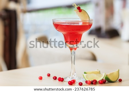 cosmopolitan cocktail garnished with a lime and berries - stock photo
