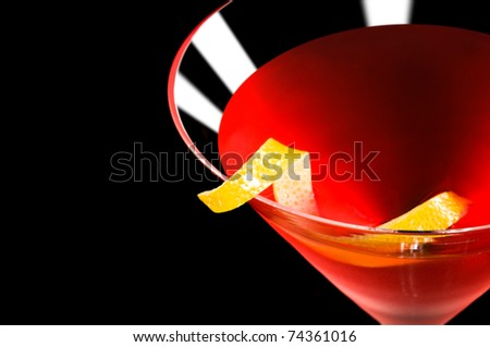 Cosmopolitan cocktail in nice red color in front of a black background - stock photo
