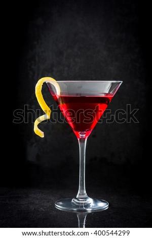 Cosmopolitan cocktail on black background  - stock photo