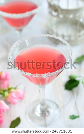 Cosmopolitan cocktail on romantic background  - stock photo