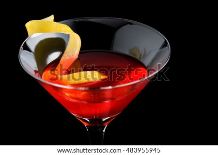 cosmopolitan cocktail with garnish on black background