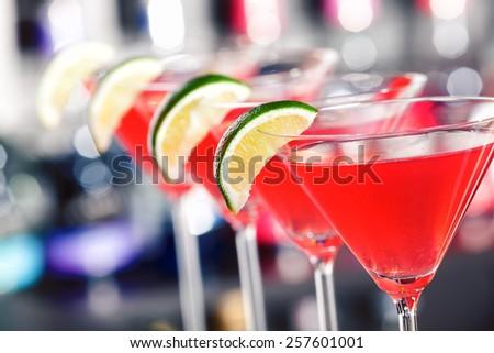 Cosmopolitan cocktails on a bar counter - stock photo