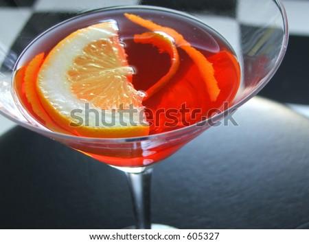Cosmopolitan martini on diner stool. - stock photo