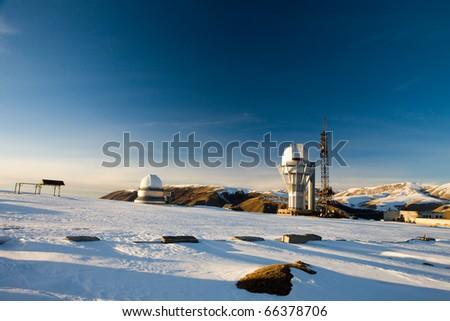 Cosmostation. Snowy plains and mountains. Asia, Kazakhstan, Plateau Assy - stock photo