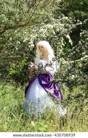 Cosplay scene / unicorn (Amalthea in the fairy forest) - stock photo