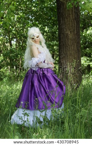 Cosplay scene / unicorn ( Amalthea is hiding in the forest) - stock photo