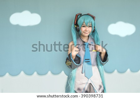 cosplay women with abstract sky and sea background  , green set - stock photo