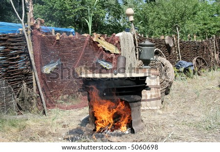 Cossack village. Preparation of the fish-soup in caldron