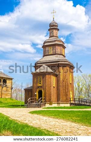 Cossack wooden church inside of the Baturin Citadel. Baturin, Ukraine.  - stock photo