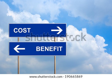 cost and benefit on blue road sign with blue sky - stock photo