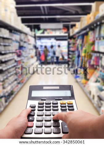 Cost of living concept by calculated the price in supermarket - stock photo