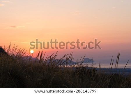 Costa Blanca sunrise with Altea bay in the background - stock photo