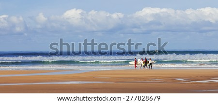 Costa de Caparica, Portugal. April 19, 2015: Surfers searching for the best spot. Caparica is an iconic location for surf in Portugal because its one of the pioneer beaches and quality of waves - stock photo