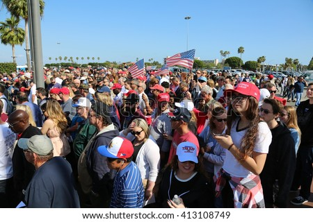 Costa Mesa, CA - April 28, 2016: Estimated 31,000 supporters of republican presidential candidate Donald Trump, cheer and wait patiently in line to hear his speech at a rally at the Costa Mesa CA.   - stock photo