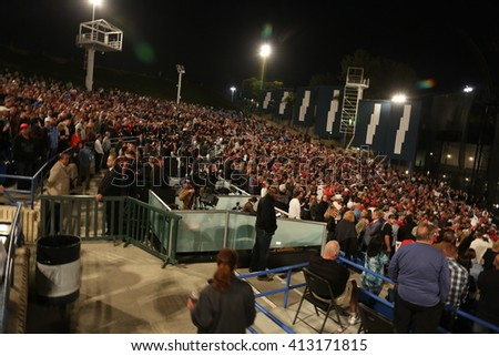 Costa Mesa, CA - April 28, 2016: Fish Eye Shots of supporters and protesters of republican presidential candidate Donald Trump, cheer and jeer while waiting to hear him speak in Costa Mesa CA.
