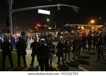 Costa Mesa, CA - April 28, 2016: Protesters of republican presidential candidate Donald Trump, Riot in the streets while the police control the crowd and make arrest  at a rally at the Costa Mesa CA. - stock photo