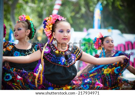 COSTA MESA, CA - JULY 24: Unidentified Mexican dancers perform in traditional costumes on stage at the Orange County State Fair in Costa Mesa, CA on July 24th 2010.