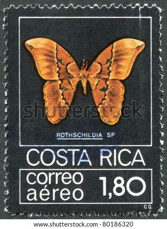 COSTA RICA-CIRCA 1979: A stamp printed in the Costa Rica shows a butterfly Rothschildia jacobaeae, circa 1979 - stock photo