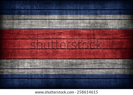 Costa Rica flag pattern on wooden board texture ,retro vintage style - stock photo