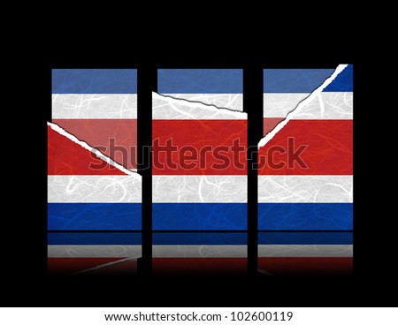 CostaRica flag of tear paper with gift cards. Mulberry paper on black background. - stock photo