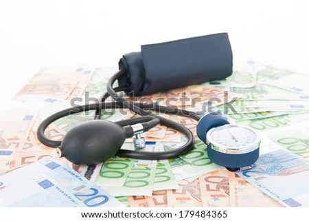 Costs of healthcare with banknotes and Blood pressure meter - stock photo