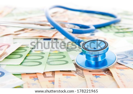 Costs of healthcare with banknotes and stethoscope - stock photo