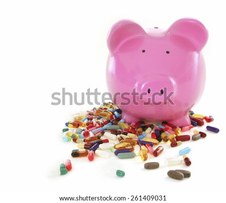 Costs of Pharmacuticals - Piggy Bank on White Background - stock photo