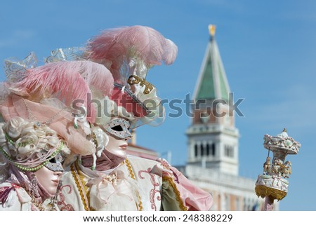 Costumed couple during Carnival in Venice - stock photo