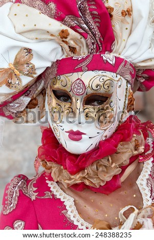 Costumed woman on the San Marco square during Carnival in Venice - stock photo