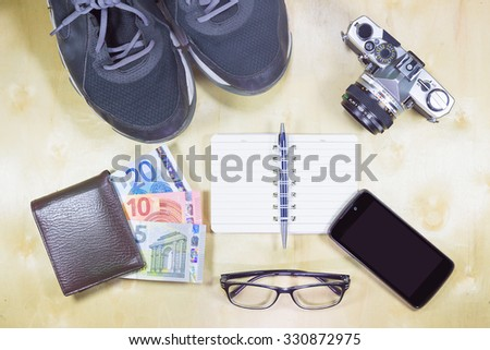 Costumes of the travelers on the wooden floor vintage style. - stock photo