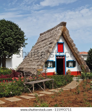 Cosy chalet with a triangular thatched roof. Madeira Island, the city Santana - stock photo