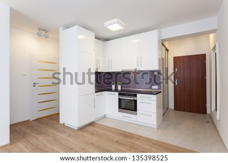 Cosy flat - white countertop in modern kitchen - stock photo
