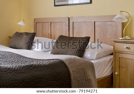 Cosy hotel bedroom for two - stock photo