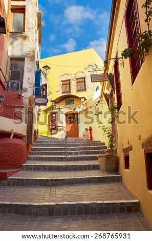 cosy street of Chania old town with stairs, Crete, Greece - stock photo