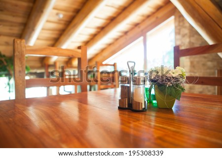 Cosy wooden restaurant - mountain chalet - stock photo