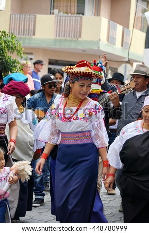 COTACACHI, ECUADOR - JULY 1, 2016: Women parade on the last day of Inti Raymi, the Quechua solstice celebration.  Women in traditional dress dance to awaken and soothe Mother Earth.