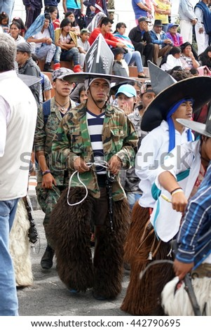 COTACACHI, ECUADOR - JUNE 23, 2016: Children's parade in Inti Raymi, the Quechua solstice celebration.  Young people stomp and dance in a circle to wake up Mother Earth.
