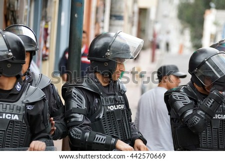 COTACACHI, ECUADOR - JUNE 24, 2016: Inti Raymi, the Quechua solstice celebration, with a history of being violent in Cotacachi.  Riot police surround the event.