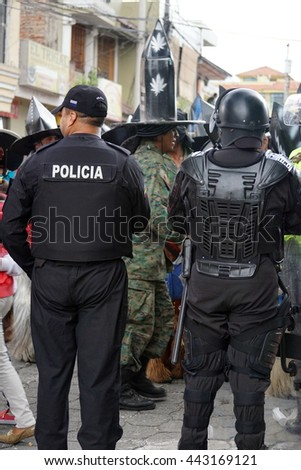 COTACACHI, ECUADOR - JUNE 25, 2016: Inti Raymi, the Quechua solstice celebration, with a history of violence in Cotacachi.  Riot police surround the square in case of violence.