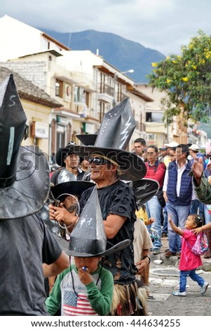 "COTACACHI, ECUADOR - JUNE 25, 2016: Inti Raymi, the Quechua solstice celebration, with a history of violence in Cotacachi.  Men stomp and march to ""take the square."""