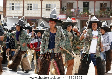 "COTACACHI, ECUADOR - JUNE 29, 2106: Inti Raymi, the Quechua solstice celebration, with a history of violence in Cotacachi.  Men race forward to ""take the square."""