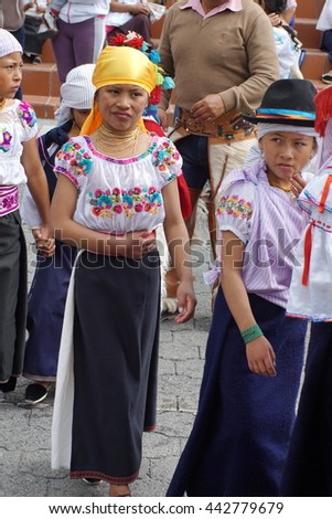 COTACACHI, ECUADOR - JUNE 23, 2016: Inti Raymi, the Quechua solstice festival, children's parade.  Girls in traditional dress march in a circle to wake up mother earth.