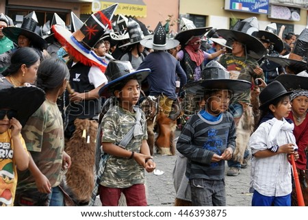 "COTACACHI, ECUADOR - JUNE 30, 2016: Inti Raymi, the Quechua solstice festival, with a history of violence in Cotacachi. Children parade ahead of the men to ""take the square."""