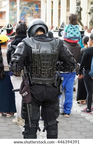 COTACACHI, ECUADOR - JUNE 30, 2016: Inti Raymi, the Quechua solstice festival, with a history of violence in Cotacachi.  Police in riot gear are on standby in case of problems.