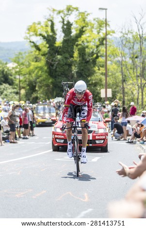 COTE DE COULOUNIEIX-CHAMIERS,FRANCE - JULY 26:Lars Bak (Lotto Belisol Team) pedaling  on a steep slope, during the stage 20 (time trial Bergerac - Perigueux) of Le Tour de France on July 26, 2014  - stock photo